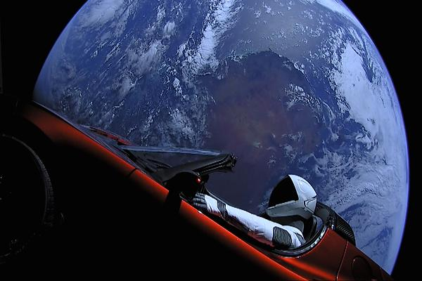Elon Musk Tesla Roadster and Starman Flying Through Space Leaving Earth
